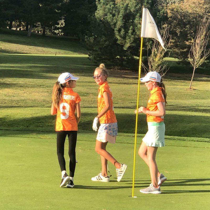 three-girls-playing-golf